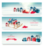 Fototapety Three Christmas banners with presents and a sleigh. Vector.