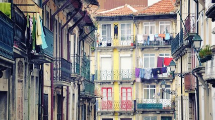 Colorful old houses of Porto with hanging clothes