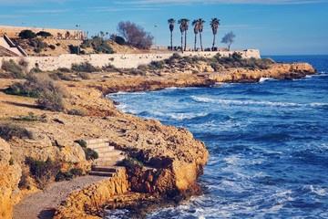 Coastline of Tarragona, Spain with sea, ruins and sky