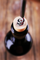 Bottle opener close-up, on wooden background