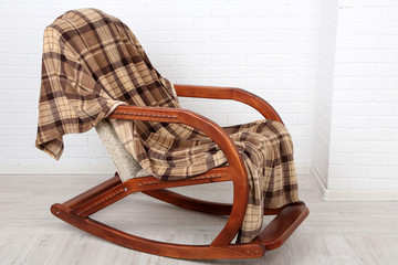 Rocking chair covered with plaid