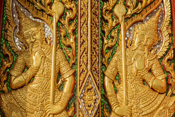 wood carving door decorated in the temple ,Thailand
