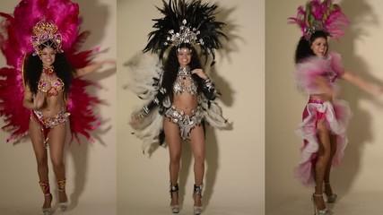 Three beautiful samba dancers wearing typical costumes