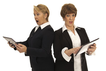 Two Business Women with Digital Tablets