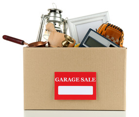 Box of unwanted stuff ready for a garage sale, isolated on