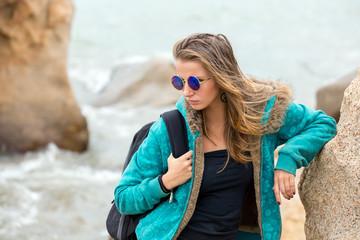 Beautiful girl with long hair on the coast