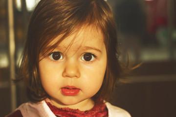 Portrait of cute sad little girl thinking. Toned