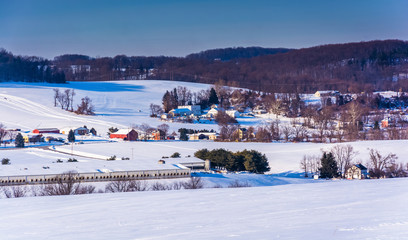 View of farms and snow-covered rolling hills in rural York Count