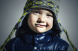 funny child.winter fashion kids.smiling little boy in cap