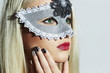 Beautiful Woman in Carnival Mask.Masquerade.Blond Girl.Manicure