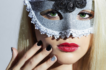 Beautiful Blond Woman in Carnival Mask.Girl.Manicure design