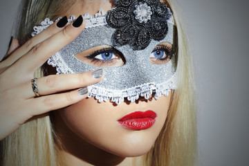 Beautiful Blond Woman in Mask.Girl with blue eyes.Manicure