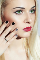 Beautiful blond Woman with Manicure.Nail design.Beauty salon