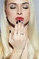 Beautiful blond Woman with Manicure.Sexy Girl.Beauty Make-up
