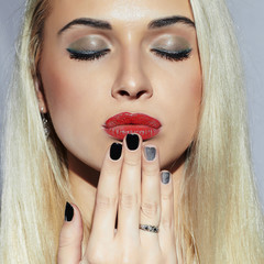Beautiful blond Woman with Manicure.Beauty Girl.Make-up