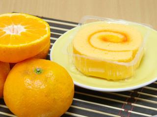 sponge roll cake with orange cream and fresh mandarin