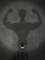 businessman casting a shadow of an athlete