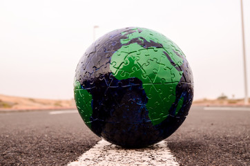 Globe Earth on an Asphalt Street
