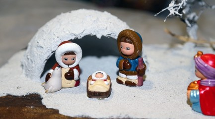 Nativity scene with Holy Family and an Eskimo igloo
