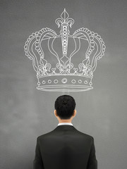 businessman with a giant crown above head