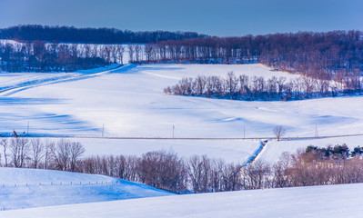 View of snow-covered rolling hills in rural York County, Pennsyl