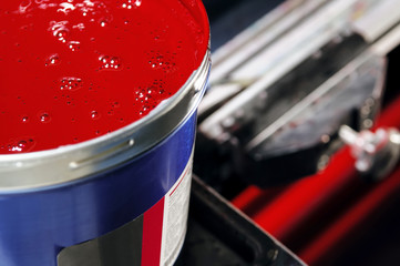 Open jar with a tight red paint