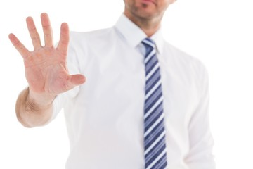 Handsome businessman gesturing with hand