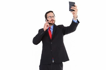 Businessman holding calculator while talking on phone