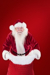 Composite image of santa open his red bag