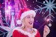 Composite image of festive blonde smiling at hand