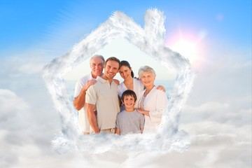 Composite image of portrait of a smiling family at the beach