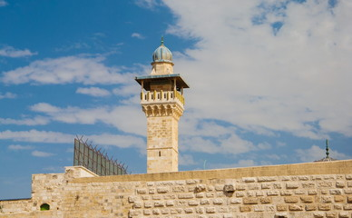 minaret and ancient walls of  mosque in Jerusalem