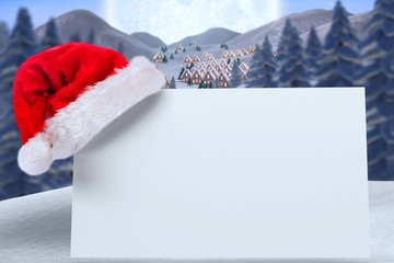 Composite image of santa hat on poster