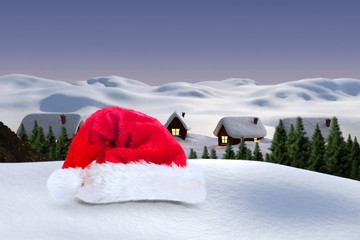 Composite image of santa hat on snow