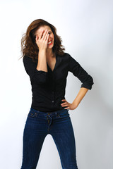 Playful shy woman hiding face laughing timid