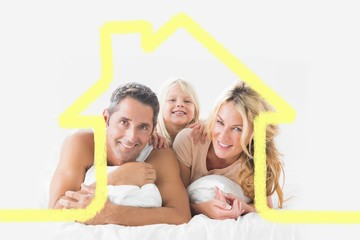 Composite image of family posing lying on a bed