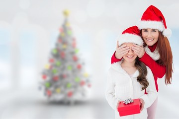 Composite image of mother and daughter with gift
