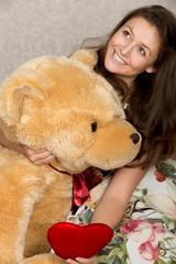 Girl with stuffed heart and bear