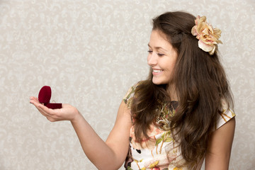 Girl holds box with ring