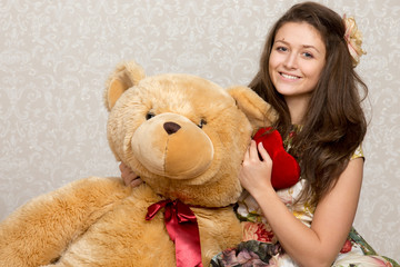 Girl with stuffed heart and bear