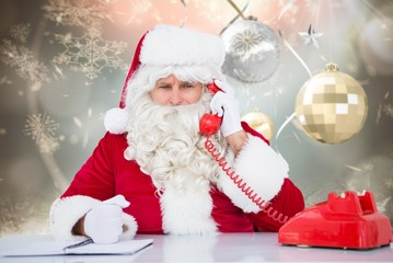 Composite image of santa on the phone