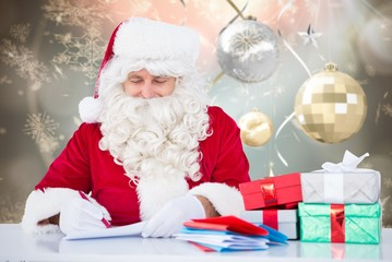 Composite image of santa writing cards
