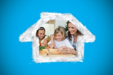 Composite image of woman making sandwiches with her children