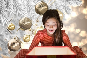 Composite image of little girl getting gift