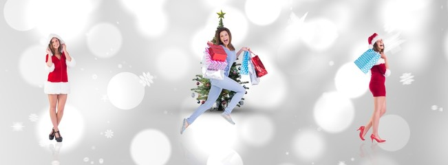 Composite image of festive brunette holding shopping bags