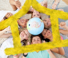 Teenagers on the floor with a terrestrial globe in the center
