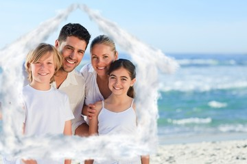 Composite image of portrait of a cute family at the beach