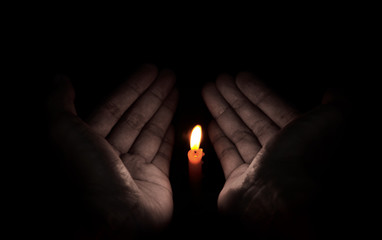 Candle light in hand, Hope concept