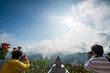 two mans taking a photo at Doi Mae Salong, north of Thailand