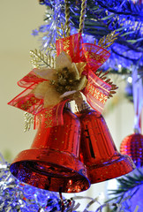 red bell in the christmas tree